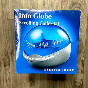 New Sharper Image Info Globe Scrolling Caller ID